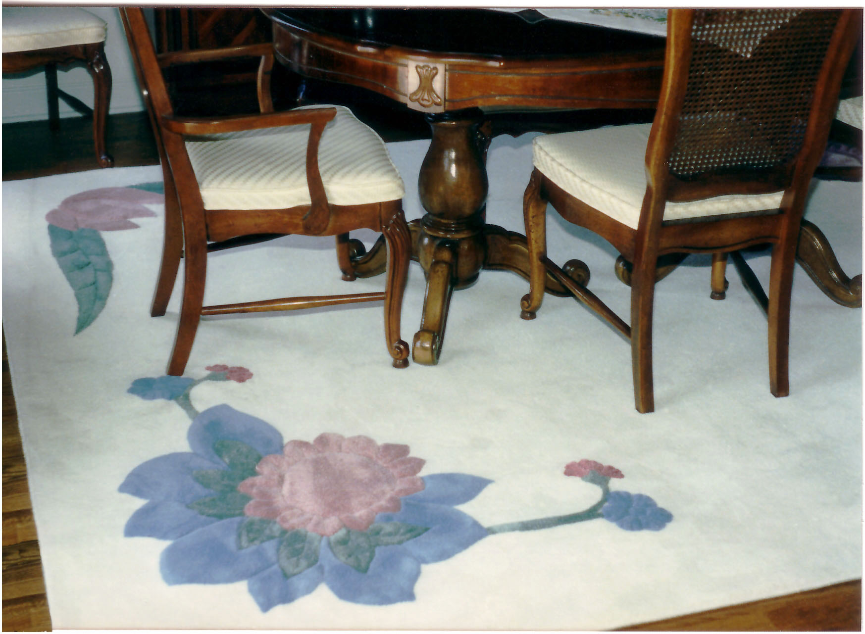 This custom floral design, created by David, gives the traditional look of this dining room a dash of whimsy.
